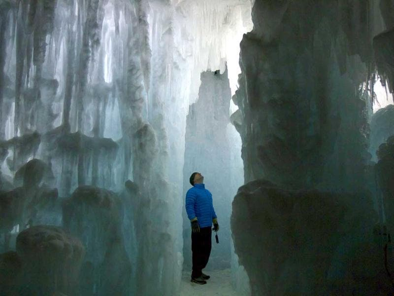 A visitor at the ice castles in Silverthorne, Colorado. The ice castles consist of man-made walkways, tunnels, and arches of ice with no supporting structures, some reaching up to a height of 30 to 40 feet. Reuters/Nathan W Armes
