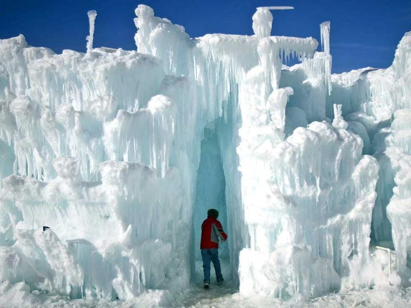 A boy runs though ice formations at the ice castles in Silverthorne, Colorado. The ice castles consist of man-made walkways, tunnels, and arches of ice with no supporting structures, some reaching up to a height of 30 to 40 feet. Reuters/Nathan W Armes