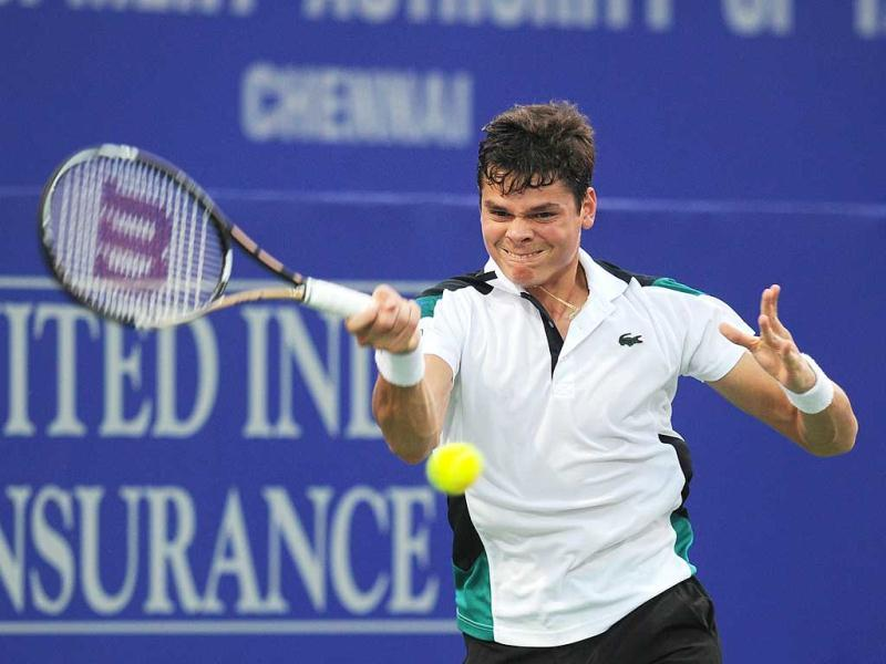 Canadian tennis player Milos Raonic returns a shot against his Romanian opponent Victor Hanescu during their second round match at the ATP Chennai Open 2012 tennis tournament in Chennai. Raonic won the match, 6-1, 6-4. AFP Photo
