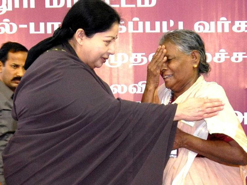 Tamil Nadu chief minister J Jayalalithaa consoling a woman who was affected by cyclone 'Thane', in Cuddalore.