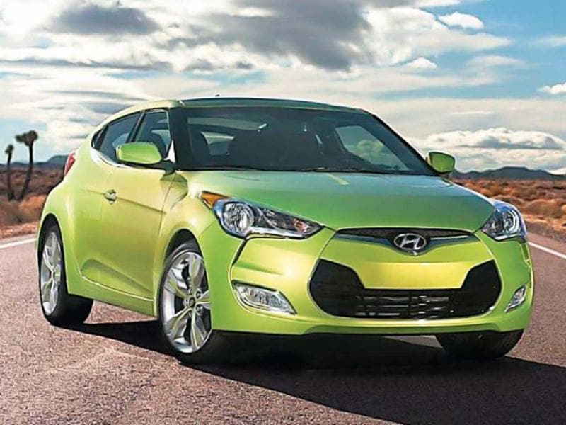 Hyundai Veloster: When Maruti launches a compact SUV, can Hyundai be left behind? The Korean giant is showcasing Veloster that sports a 1511 cc engine. The crossover vehicle that has already made it to the Korean and US markets grabs attention with its fluidic design.