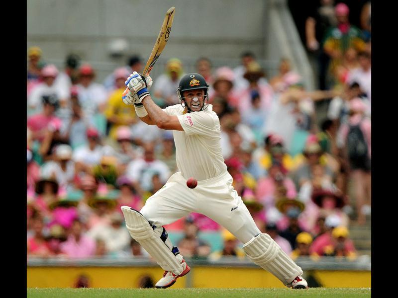 Australian batsman Michael Hussey plays a cut shot on day three of the second cricket Test against India at the Sydney Cricket Ground. (AFP Photo)