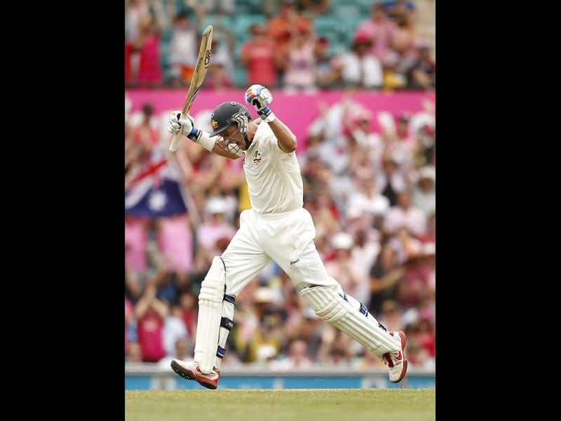 Australia's Mike Hussey celebrates reaching a century against India during the second cricket test, at the Sydney Cricket Ground.  (Reuters)
