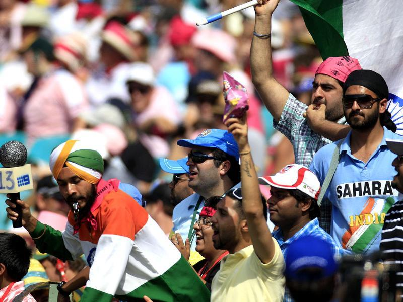 Indian cricket fans cheer as India and Australia play on the third day in their cricket test match at the Sydney Cricket Ground in Sydney. (AP Photo/Rick Rycroft)