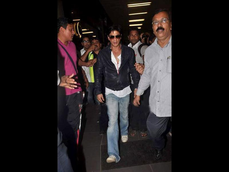 Shah Rukh Khan walks away.