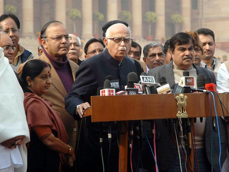 Senior BJP leader LK Advani addresses the media as BJP President Nitin Gadkari and leaders of opposition Arun Jaitley, Sushma Swaraj and other BJP leaders watch after meeting with President Pratibha Patil in New Delhi. AFP/Raveendran