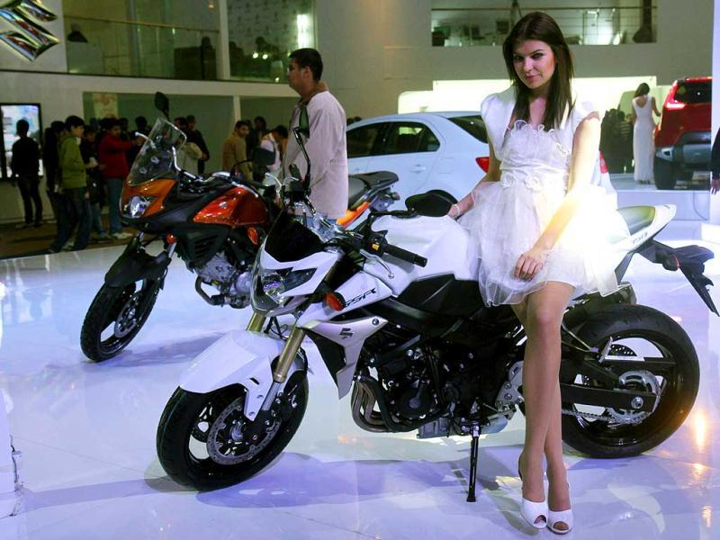 A model rest on a newly launched Suzuki bike during Auto Expo 2012 at Pragati Maidan in New Delhi. HT Photo/Mohd Zakir