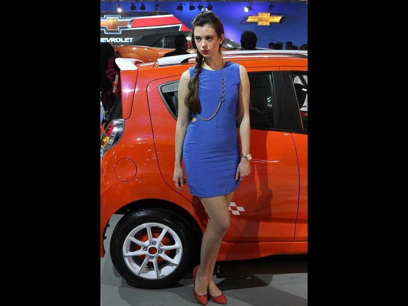 A model with Chevrolet Beat car during the 11th Auto Expo 2012 at Pragati Maidan in New Delhi. HT Photo by Virendra Singh Gosain