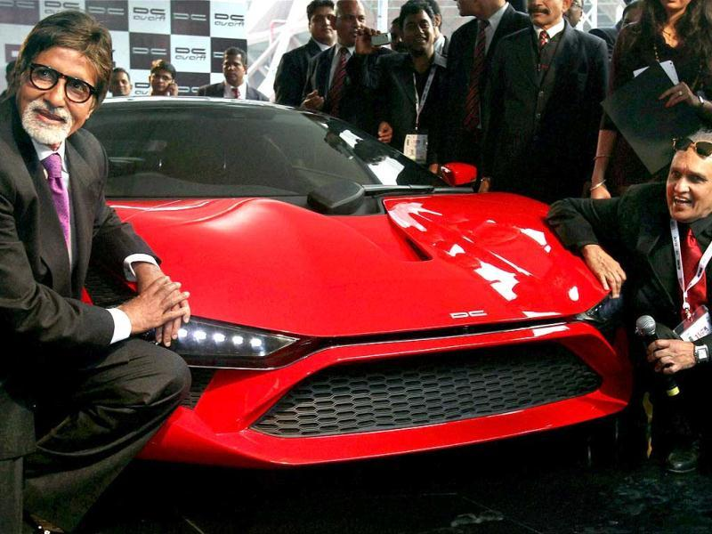 Amitabh Bachchan and car designer Dilip Chhabria pose with Supercar-DC Avanti at the 11th Auto Expo 2012 at Pragati Maidan in New Delhi. PTI Photo by Vijay Verma