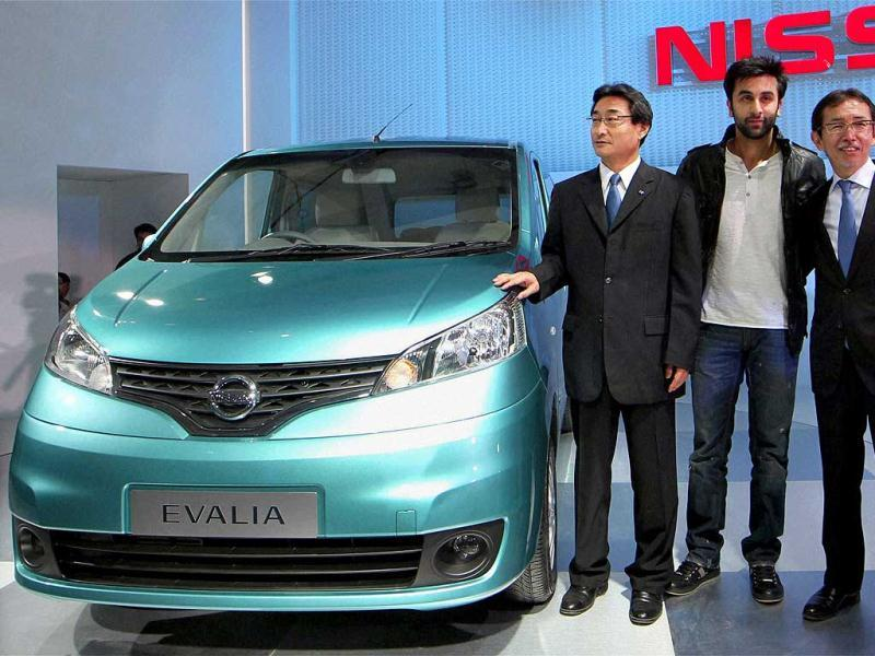 Ranbir Kapoor and Nissan officials pose with the company's Evalia car at the 11th Auto Expo 2012 at Pragati Maidan in New Delhi. PTI Photo by Kamal Singh