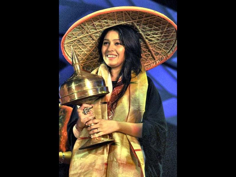 Bollywood Singer Sunidhi Chauhan being felicitated with Assamese japi at the Mega Musical Concert in Nagaon, Assam on Wednesday night.