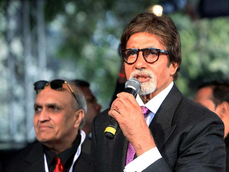 Actor Amitabh Bachchan addressing the media as car designer Dilip Chhabria looks on during the Supercar-DC Avanti launch at the 11th Auto Expo 2012 at Pragati Maidan in New Delhi. PTI Photo/Shahbaz Khan.