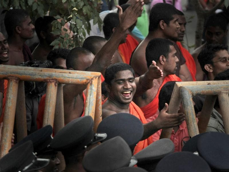 A Sri Lankan student Buddhist monk reacts to police officers as they block a protest march of university students in Colombo, Sri Lanka. Sri Lankan university students were trying to march to the residence of the President Mahinda Rajapaksa demanding him to stop politicizing the country's university system. AP Photo/ Eranga Jayawardena