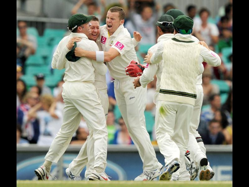 Australian captain Michael Clarke celebrates after taking the wicket of Sachin Tendulkar on day four of the second cricket Test at the Sydney Cricket Ground. (AFP Photo)
