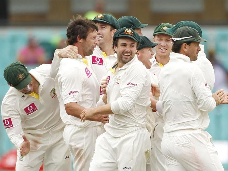 Team mates congratulate Australia's Ben Hilfenhaus for taking the wicket of India's captain MS Dhoni during the second cricket Test, at the Sydney Cricket Ground. (Reuters)