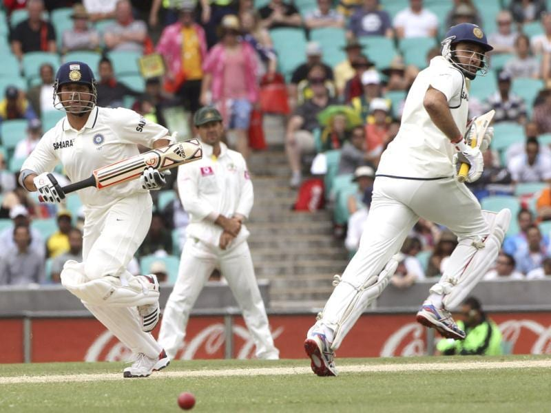 Sachin Tendulkar left, and VVS Laxman run between the wicket on the fourth day of the second Test match at the Sydney Cricket Ground in Sydney.(AP Photo)