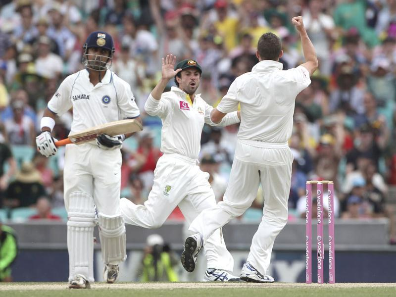 Australia's cricket players Ed Cowan, center, and Peter Siddle celebrate taking the wicket of Gautam Gambhir on the fourth day of the second Test match at the Sydney Cricket Ground in Sydney, Australia. (AP Photo)