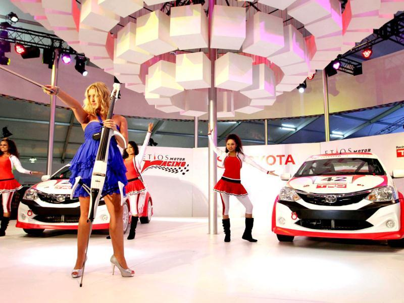 Artists perform during the launch of Toyota's Etios, a motor racing concept car, at the 11th Auto Expo, at Pragati Maidan in New Delhi.(Arvind Yadav/HT)
