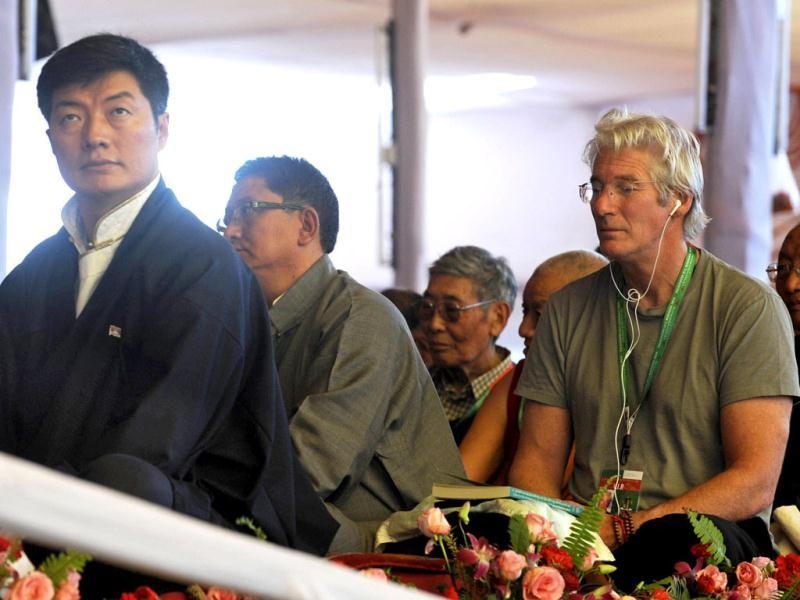 Tibet's prime minister-in-exile Lobsang Sangay (L) along with US actor Richard Gere (R) attend the teaching session of Tibetan spiritual leader the Dalai Lama. (AFP)