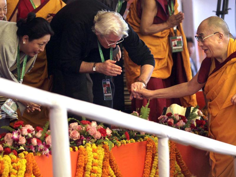 Tibetan spiritual leader the Dalai Lama, right, shakes hands with Hollywood actor Richard Gere during the Kalachakra Buddhist festival in Bodh Gaya. (AP)