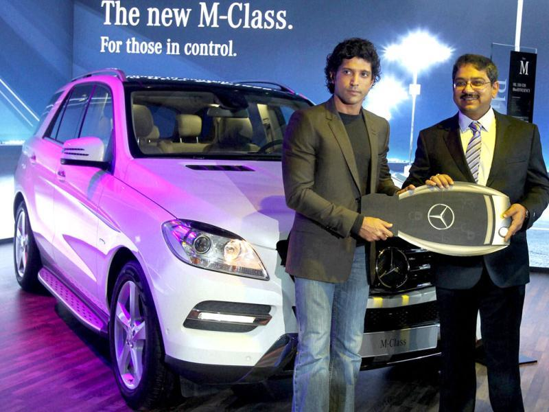 Farhan Akhtar poses with the company's M-Class car at the 11th Auto Expo 2012.