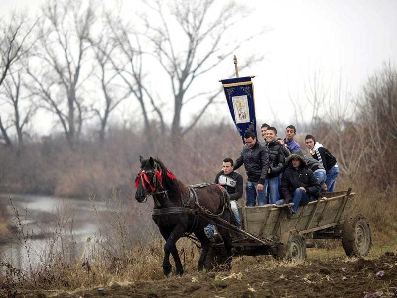 Villagers travel on a horse cart to attend the Orthodox Epiphany Day celebrations in Serdanu village, 50 km (31 miles) northwest of Bucharest. Reuters photo/Radu Sigheti