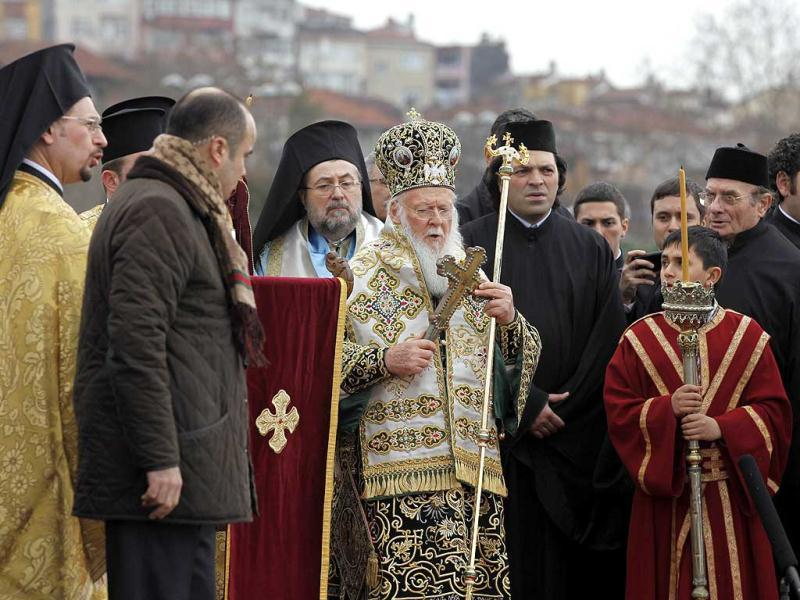 Greek Orthodox Ecumenical Patriarch Bartholomew (C) leads the Epiphany ceremony in Istanbul. Greek Orthodox swimmers raced to retrieve the wooden crucifix thrown into the Golden Horn in Bosphorus by the Ecumenical Patriarch Bartholomew as part of Epiphany Day celebrations. Reuters photo / Osman Orsal