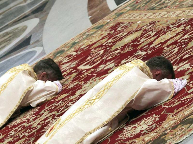 Two newly ordained bishops, Charles John Brown (R) and Marek Solczynski (L), lie prostrate in front of Pope Benedict XVI during a mass in St. Peter's Basilica at Vatican City. The Pontiff also held a mass to celebrate The Epiphany, seen as the culmination of the Christmas festive period. Reuters photo / Alessandro Bianchi