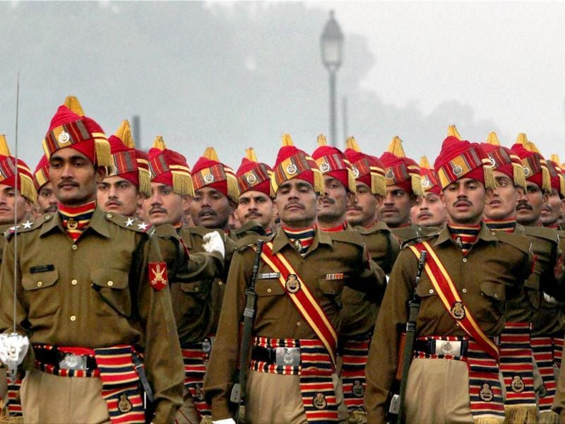 BSF jawans march as they rehearse for the 63rd Republic Day parade at Rajpath in New Delhi. PTI Photo/Vijay Verma
