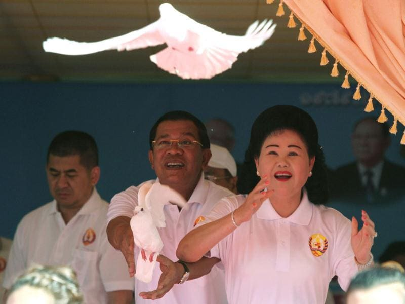 Vice President of the Cambodian People's Party and Prime Minister Hun Sen (C) and his wife Bun Rany release doves into the sky at the Cambodian People's Party (CPP) headquarters to mark the 33rd anniversary of the toppling of Pol Pot's Khmer Rouge regime in Phnom Penh. Some 1.7 million people are believed to have died in the