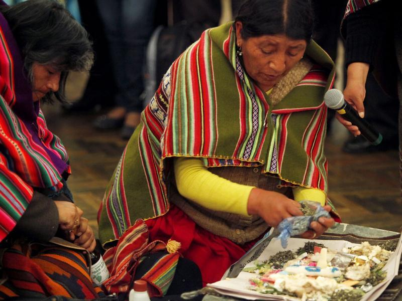 Two women konwn as 'Amautas' or Spiritual Counselors, prepare an Andean ritual at the presidential palace in La Paz, Bolivia. The so-called 'Amautas', or spiritual counselors, led the ritual organized to thank the 'Pachamama,' or Mother Earth, and to ask it for prosperity for Bolivia's President Evo Morales, his Vice President Alvaro Garcia Linera and their government. AP Photo/Juan Karita