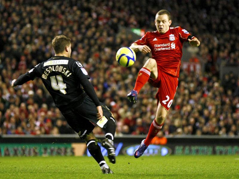 Liverpool's Jay Spearing, right, vies for the ball against Oldham Athletic's James Wesolowski during their FA Cup third round soccer match at Anfield, Liverpool, England. AP Photo/Tim Hales