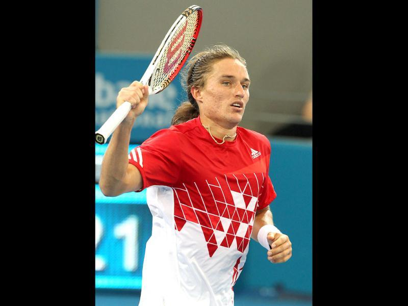 Alexandr Dolgopolov of Ukraine reacts after winning his semifinal match against Gilles Simon of France 6-3, 6-4 during the Brisbane International tennis tournament. (AP Photo/Tertius Pickard)