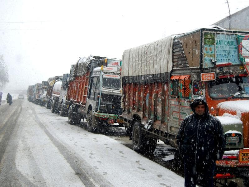 Stranded trucks on Jammu-Srinagar highway near the Jawahir Tunnel that is closed due to heavy snowfall near Srinagar. PTI Photo