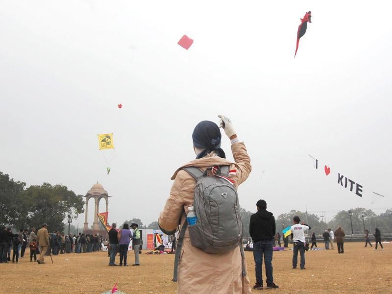 People flying kites at India Gate on the occasion of Kite festival 2012, in New Delhi.