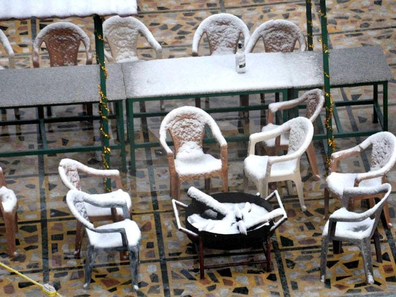 Chairs are seen covered with snow at a 'pandal' after the season's first snowfall in Mussoorie. PTI Photo