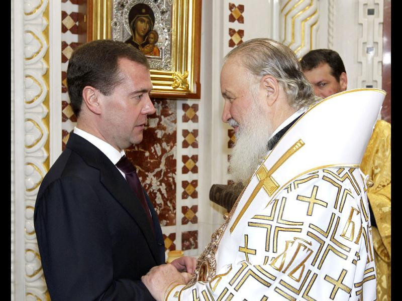 Russian Orthodox Church Patriarch Kirill (R) congratulates Russian President Dmitry Medvedev during an Orthodox Christmas at Christ The Savior Cathedral in Moscow. (AP Photo/RIA Novosti, Vladimir Rodionov, Presidential Press Service)