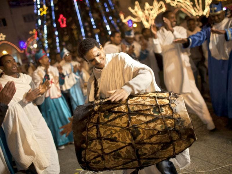 Orthodox worshippers, originally from Eritrea, dance outside the Church of the Nativity, traditionally believed by Christians to be the birthplace of Jesus Christ, during Orthodox Christmas celebrations in the West Bank city of Bethlehem. (AP Photo/Bernat Armangue)