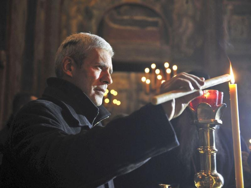 President of Serbia Boris Tadic lights a candle in the Visoki Decane Serb Orthodox Monastery during his visit for the Orthodox Christmas in western Kosovo town of Decane. (AP Photo/Visar Kryeziu)