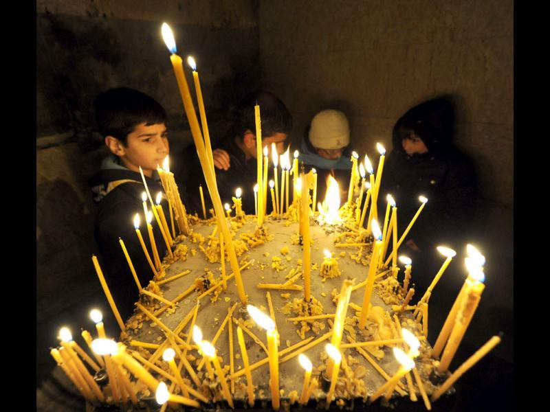 Christmas falls on January 7 for Orthodox Christians in the Middle East, Russia and other Orthodox churches that use the old Julian calendar instead of the 16th-century Gregorian calendar adopted by Catholics, Protestants, Greek Orthodox and commonly used in secular life around the world. (AFP Photo/Vano Shlamov)