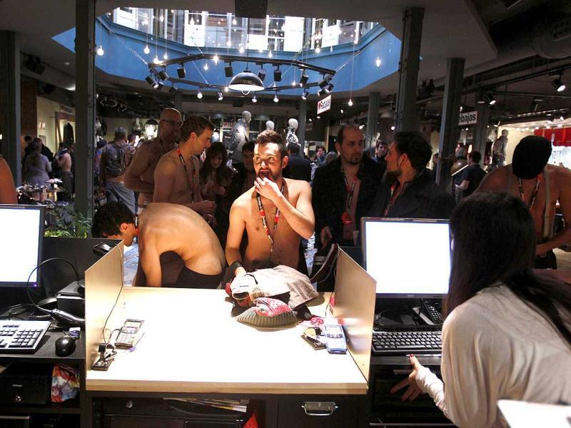 People in their underwear are seen in a clothing store in Seville. A clothing brand marked the start of sales by offering the first 100 customers free clothes, as long as they showed up in their underwear. Reuters/Marcelo del Pozo