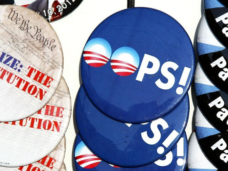 Buttons are displayed in Nashua, NH, prior to the arrival of Republican presidential candidate, Rep. Ron Paul, R-Texas for a campaign rally. (AP Photo/Charles Krupa)
