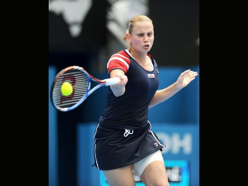 Jelena Dokic of Australia returns the ball during her first round match against compatriot Isabella Holland at the Sydney International. (AFP Photo/Greg Wood)