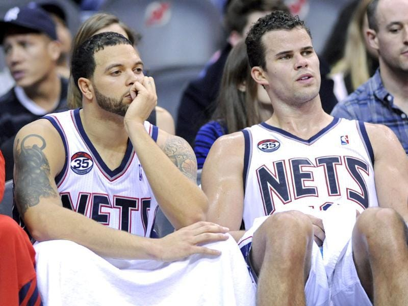 New Jersey Nets' Deron Williams (L) and Kris Humphries look on from the bench during the fourth quarter of an NBA basketball game against the Miami Heat Saturday in Newark. (AP Photo/Bill Kostroun)