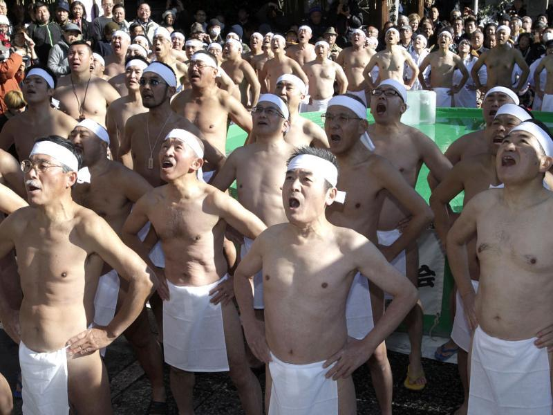 Japanese physical fitness enthusiasts pray before taking a dip in icy water during a winter ritual to keep themselves fit and to display their perseverance at Teppozu Inari Shinto shrine in Tokyo. (AP Photo/Shizuo Kambayashi)