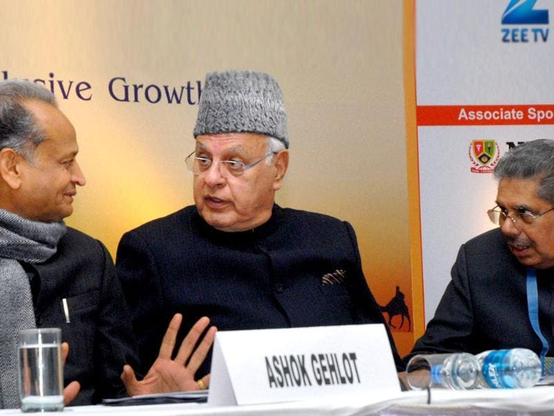 Union minister for renewable energy Farooq Abdullah, overseas Indian affairs Vayalar Ravi and Rajasthan chief minister Ashok Gehlot discuss a point at a seminar on the opening day of the Pravasi Bharatiya Divas 2012 in Jaipur. PTI Photo