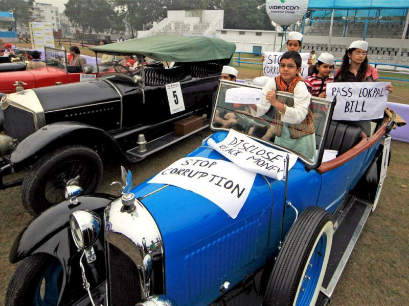 Participants with their old model cars wait for the start of a 'Vintage car rally in Kolkata. PTI Photo/Swapan Mahapatra