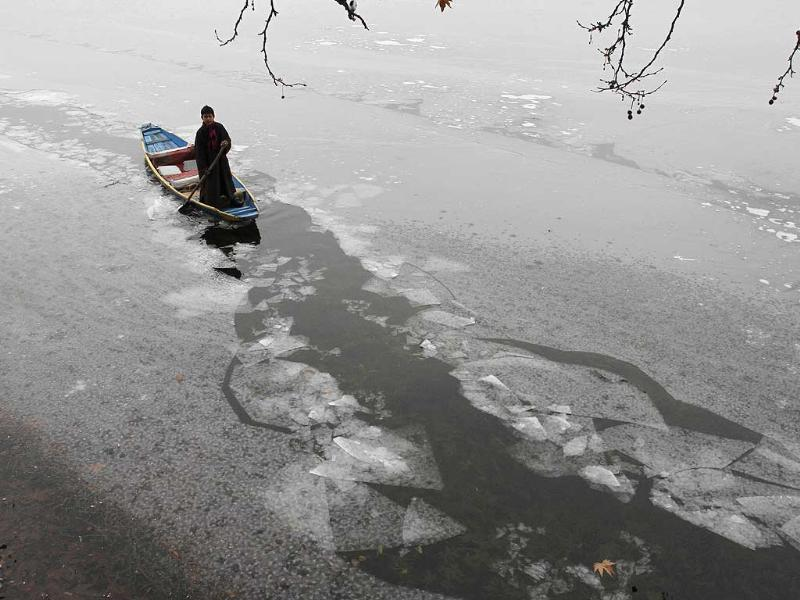 A Kashmiri boy rows a traditional boat on the Dal Lake in Srinagar. Many parts of northern India received snowfall in recent days, closing roads and hindering transport in some parts of the region including the main highway in Jammu and Kashmir. (AP Photo/Mukhtar Khan)