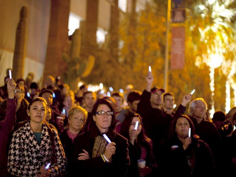 People attend a vigil for victims and survivors of the Tuscon shooting on the first anniversary of the incident, at the University of Arizona campus in Tucson, Arizona. (Reuters/Laura Segall)