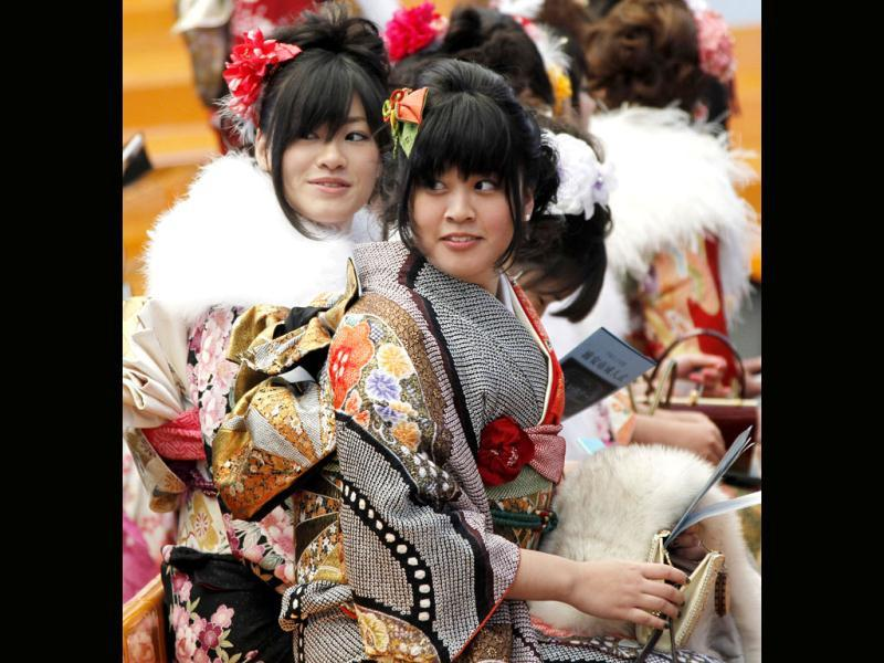 Young women, who'll be 20 years old this year, are all dressed in Japanese kimono and attend a coming-of-age ceremony at Tokyo Disneyland in Urayasu. (AP Photo/Koji Sasahara)